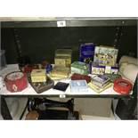 A shelf of collectors tins.