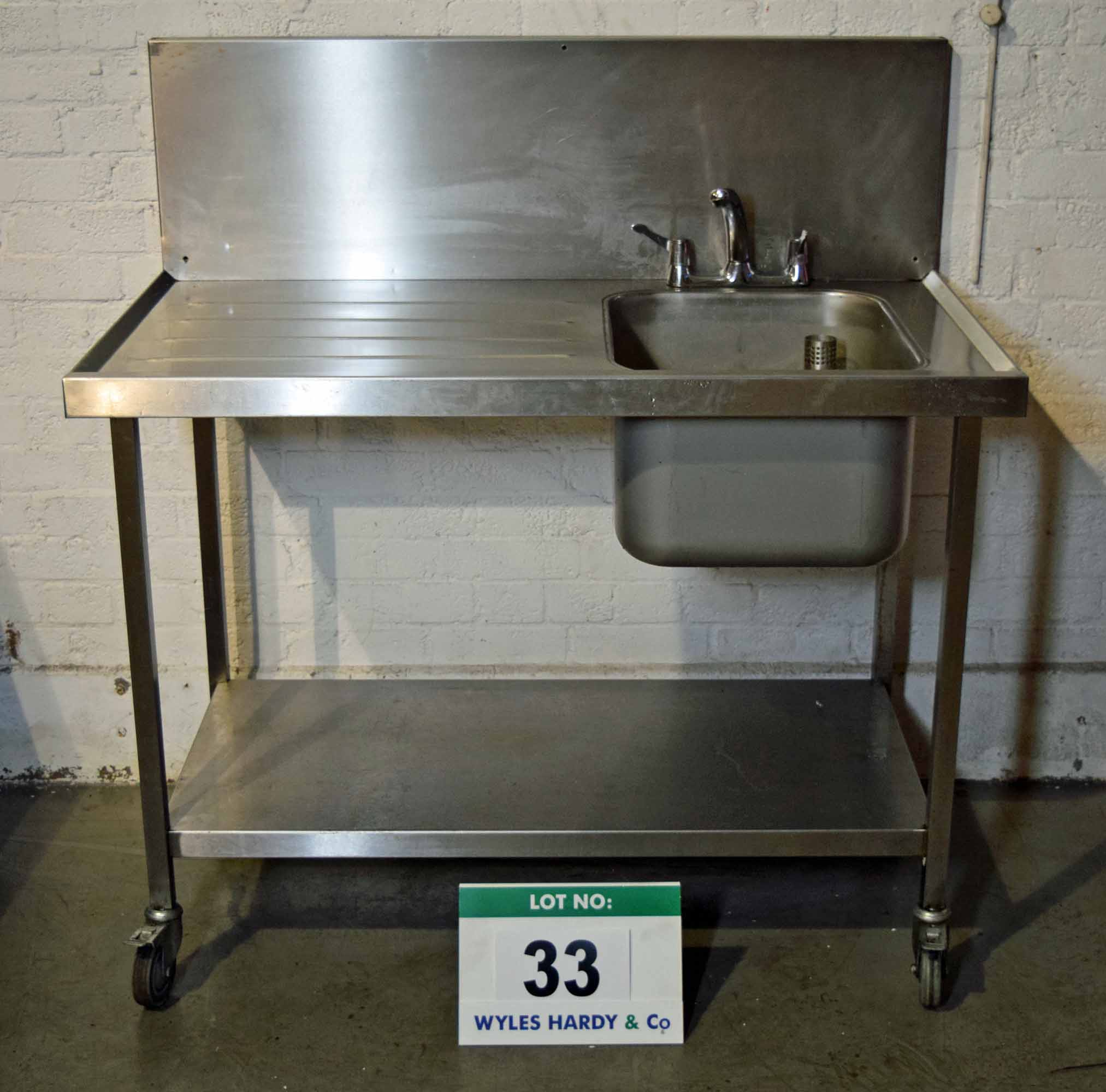 Lot 33 - A 1200mm Stainless Steel Single Bowl, Single Drainer Kitchen Sink on Castor Wheels, fitted Mixer Tap