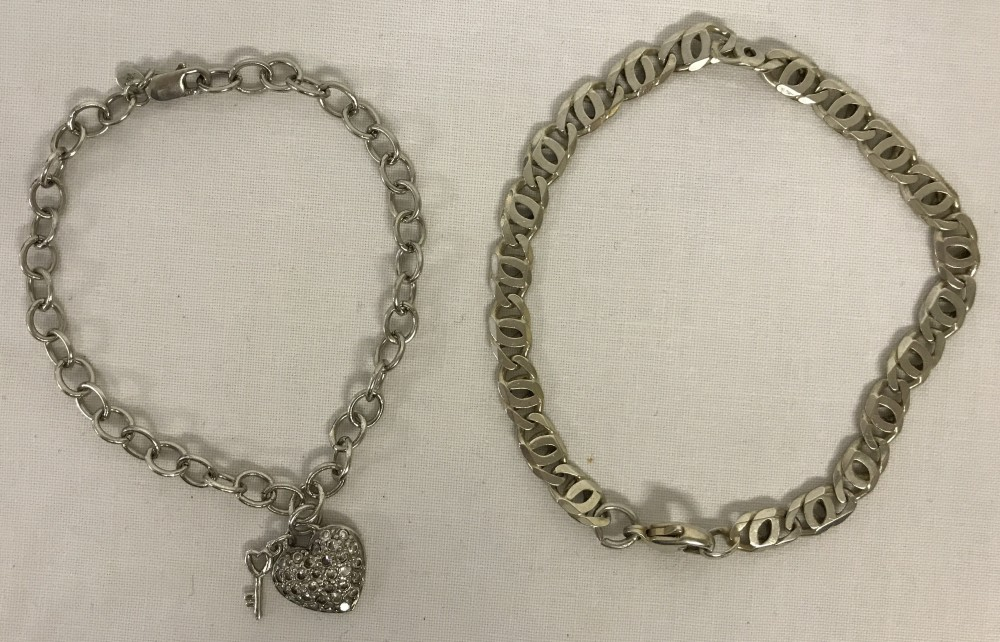 Lot 1053 - 2 x silver chain bracelets.