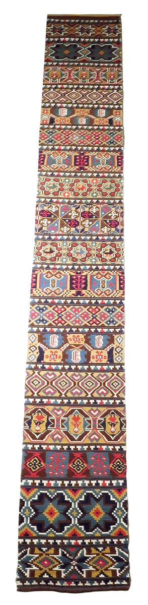 Lot 62 - A Swedish flat weave tapestry runner, with panels of geometric designs, figures, dated '1883 and