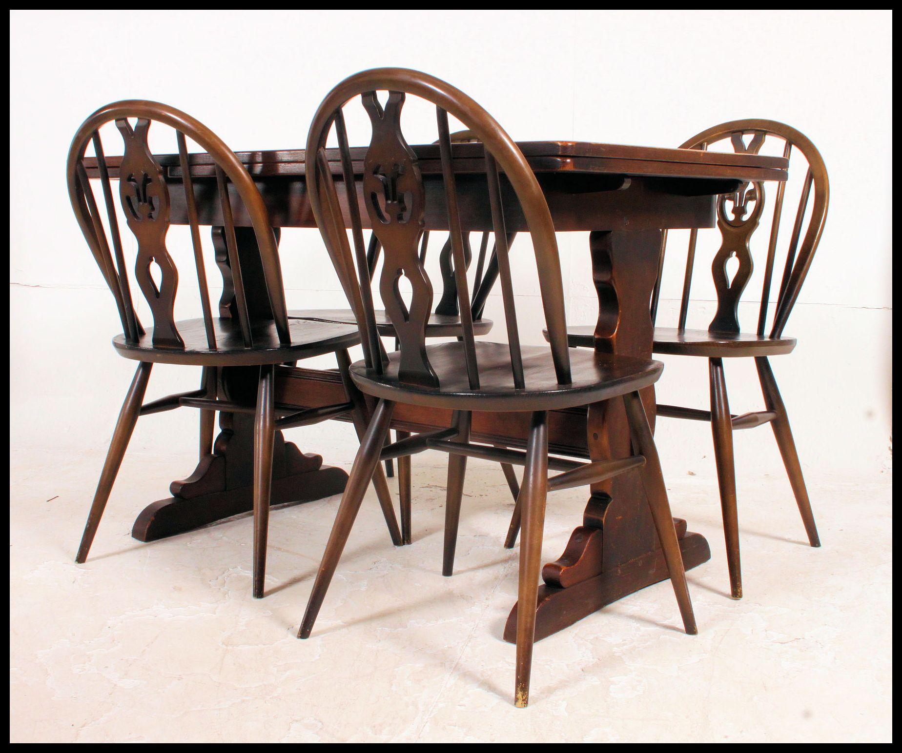 An early ercol dark wood draw leaf refectory dining table for Dark wood dining table with leaf