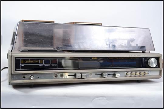 A 1970's retro Binatone hi-fi system with digital display having