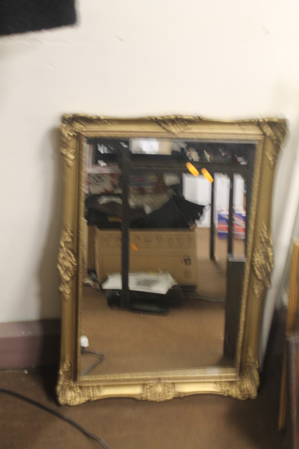 A GILT FRAMED MIRROR 80 X 58 CM