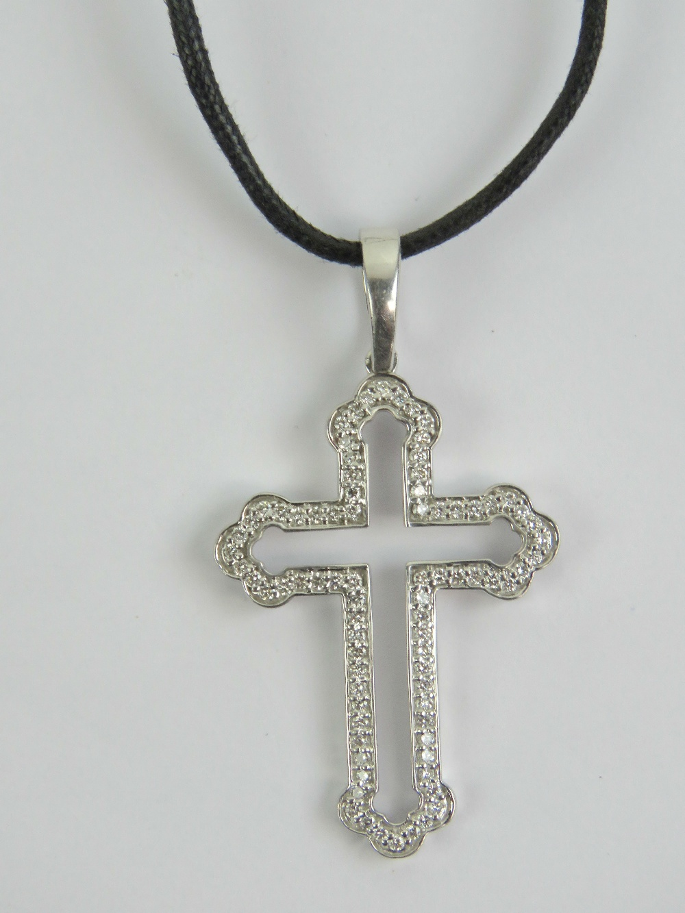 Lot 201 - An 18ct white gold cross set with diamon