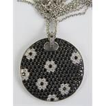 An 18ct gold pendant set with black sapp