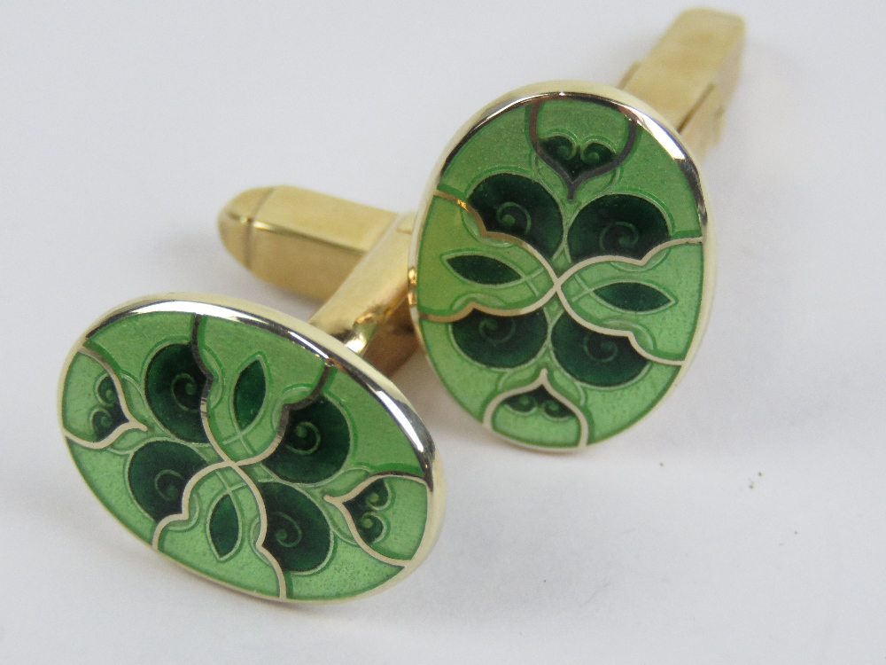 Lot 164 - A pair of 9ct gold and green enamel cuff