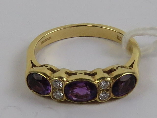 Lot 119 - An 18ct gold amethyst and diamond ring,