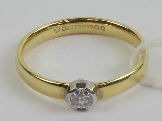 Lot 200 - An 18ct gold solitaire diamond ring, the