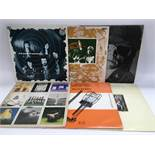 Six LPs by various artists including Pink Floyd, Caravan, Billy Bragg, Lou Reed and Paul Simon.