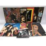 Nine LPs and a 7 inch single by various artists including The Rolling Stones, Santana, Bob Marley