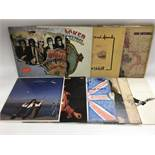 A collection of singer songwriter LPs by various artists including Elton John, Joni Mitchell, John