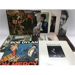 A collection of 24 Bob Dylan and related LPs including 'Highway 61 Revisited', 'Desire', 'The