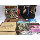 A collection of LPs by various artists from the 1960s including The Beatles, Jimi Hendrix, Big