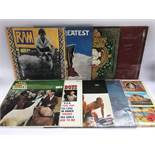 A collection of various rock and pop LPs by various artists including The Beach Boys, Love, Roy