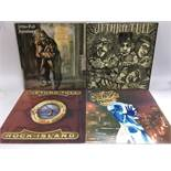 Four Jethro Tull LPs comprising 'Stand Up', 'Aqualung', 'War Child' and 'Rock Island'.