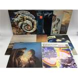A collection of Moody Blues and related LPs.
