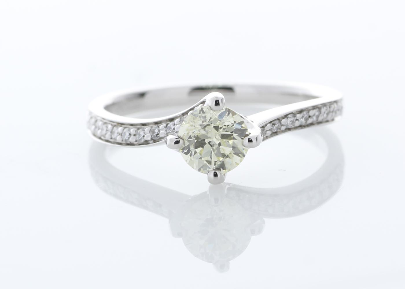 Lot 25 - 18k White Gold Single Stone with Diamond set Shoulders Ring 0.72
