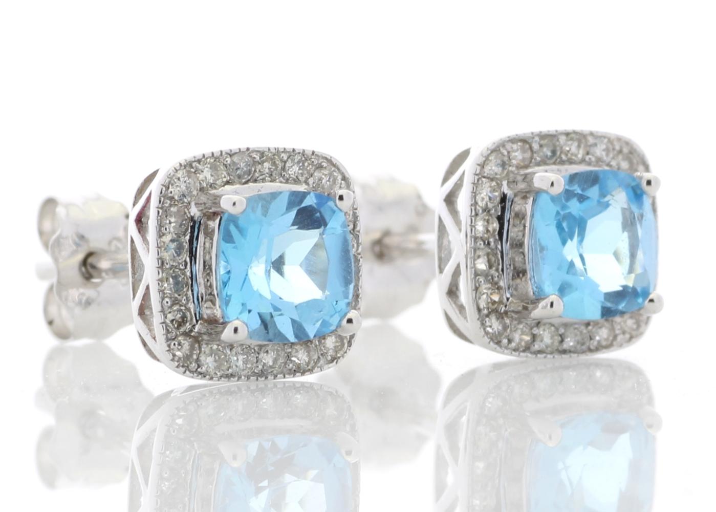 Lot 50 - 9k White Gold Blue Topaz Diamond Earring 0.20