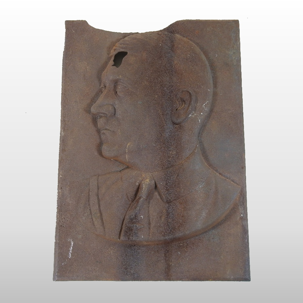 Lot 38 - A cast iron portrait plaque, relief decorated with the head and shoulders of Adolf Hitler,