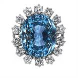 AN AQUAMARINE AND DIAMOND RING in 18ct white gold, the oval cut aquamarine of 16.25 carats encircled