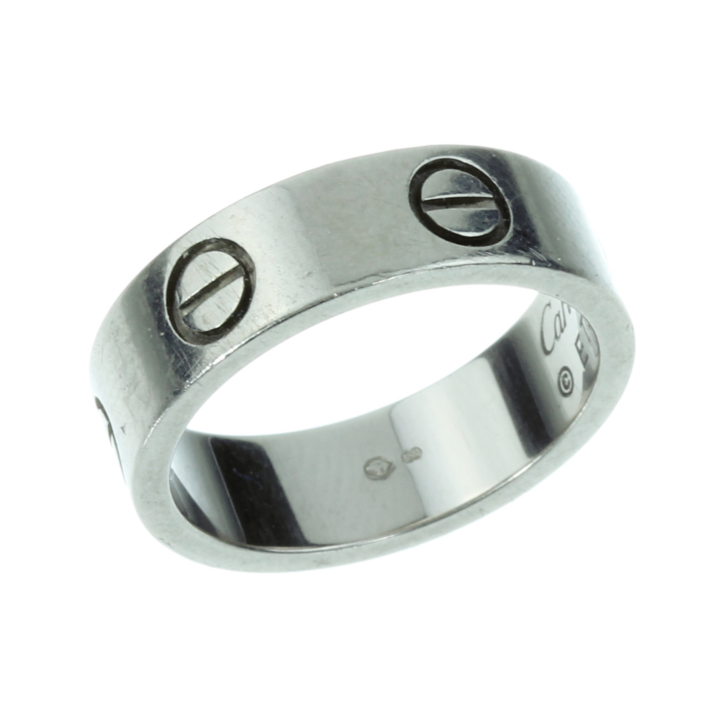 Los 3 - A LOVE RING, CARTIER in 18ct white gold punctuated with screw head motifs, signed Cartier and