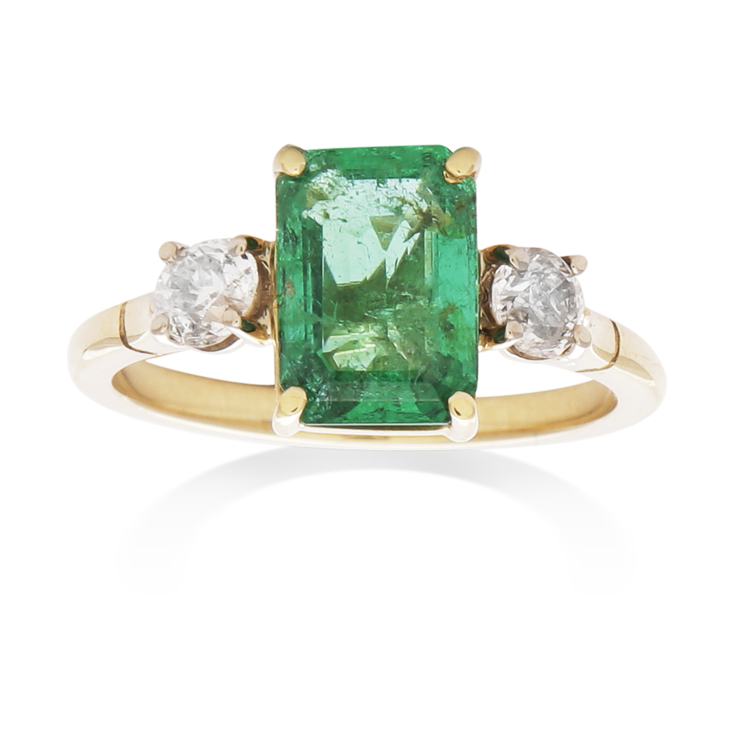 Los 8 - AN EMERALD AND DIAMOND DRESS RING in high carat yellow gold, set with a central emerald of 1.82