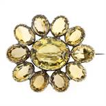 AN ANTIQUE CITRINE BROOCH, 19TH CENTURY in silver, set with a cluster of oval cut citrines,