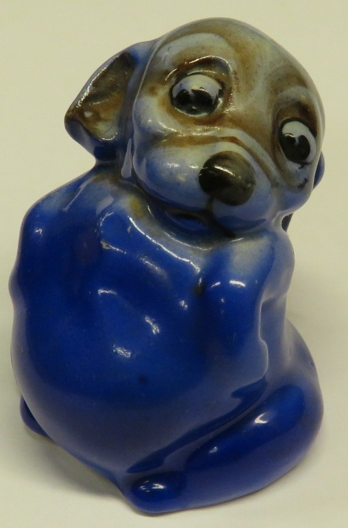 Lot 21 - Doulton 'Bonzo' porcelain model of a small seated dog looking over its shoulder, blue glaze, the