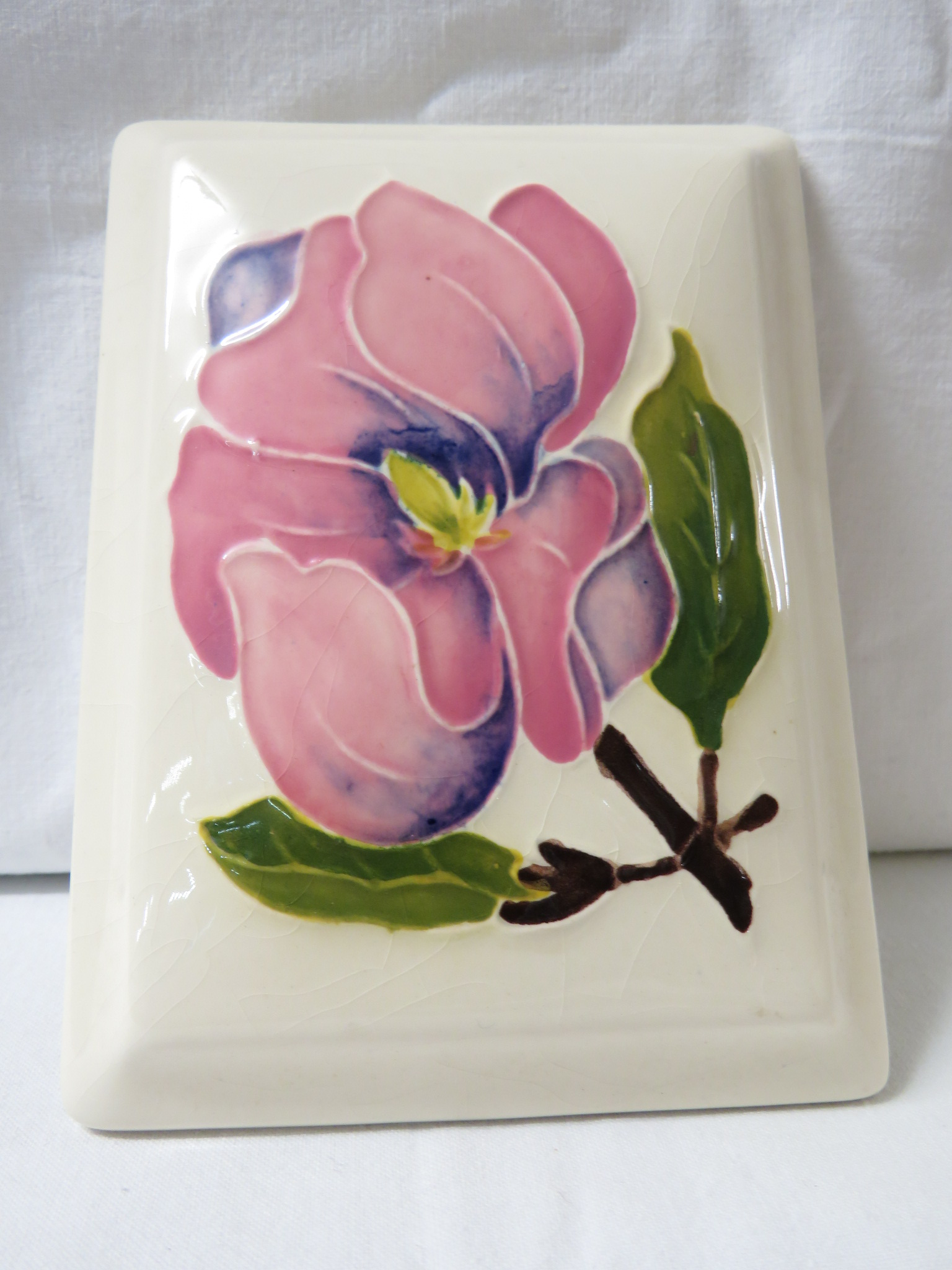 Lot 4 - Moorcroft pottery rectangular lidded dish, cream ground, the lid painted with a pink magnolia,