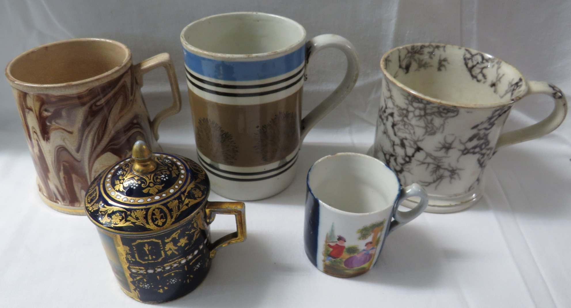 Lot 41 - A Mocha Ware tankard (height 12.5cm), two other pottery tankards, a damaged Augustus Rex coffee