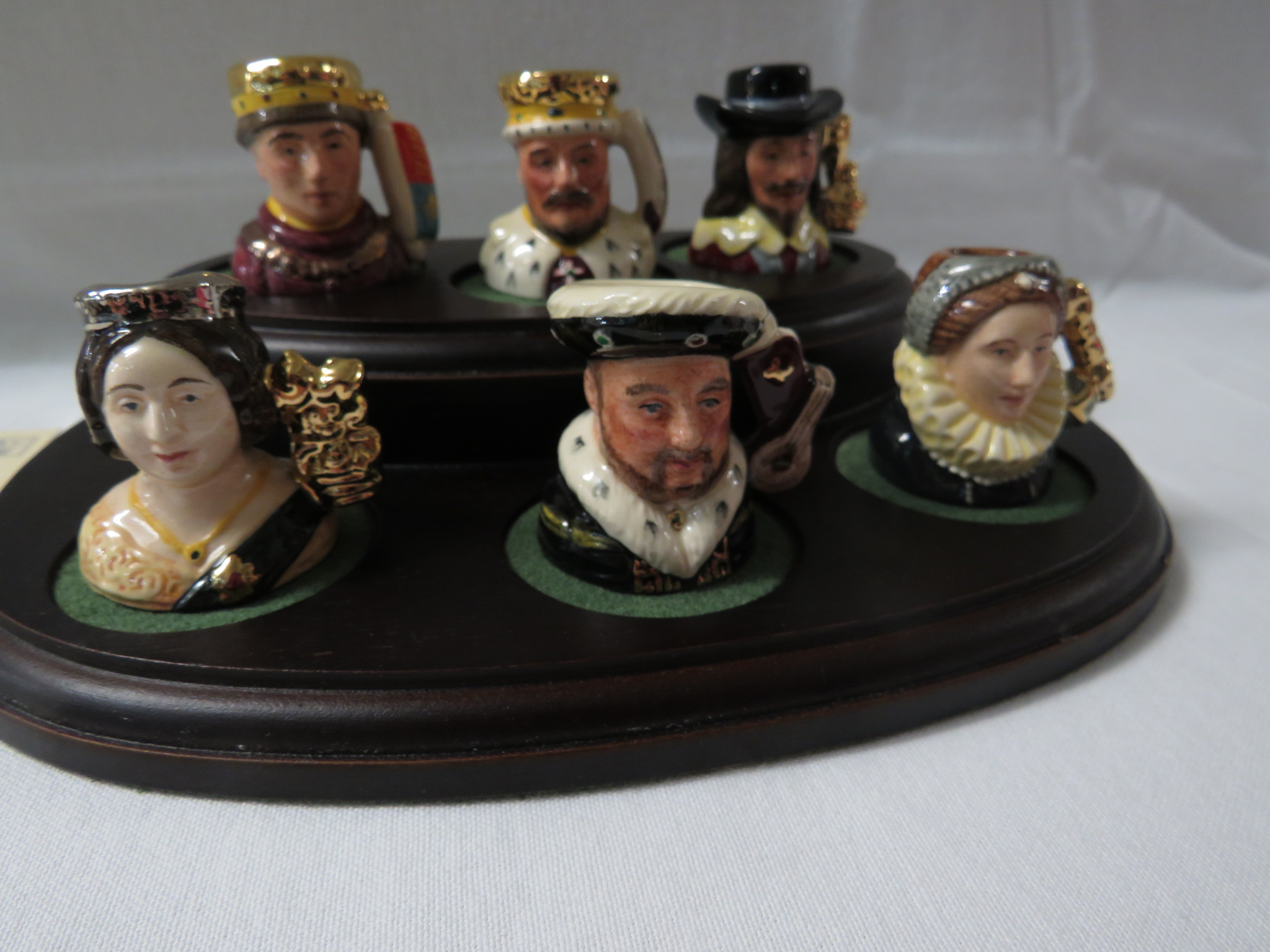 Lot 24 - Royal Doulton Kings and Queens of the Realm collection of six hand-made miniature character jugs
