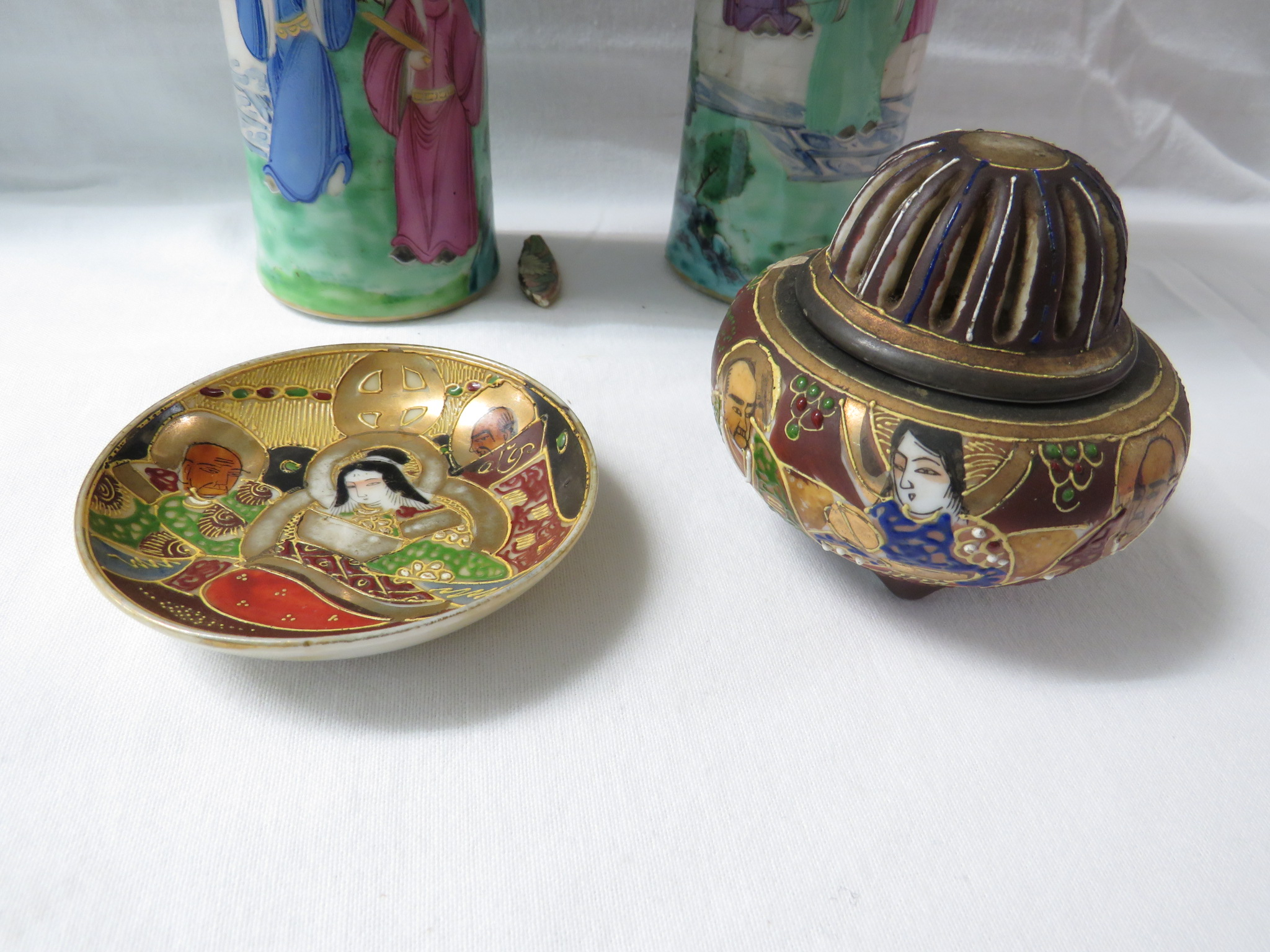 Lot 33 - A pair of Chinese porcelain famille rose vases, cylindrical with flared necks, decorated with
