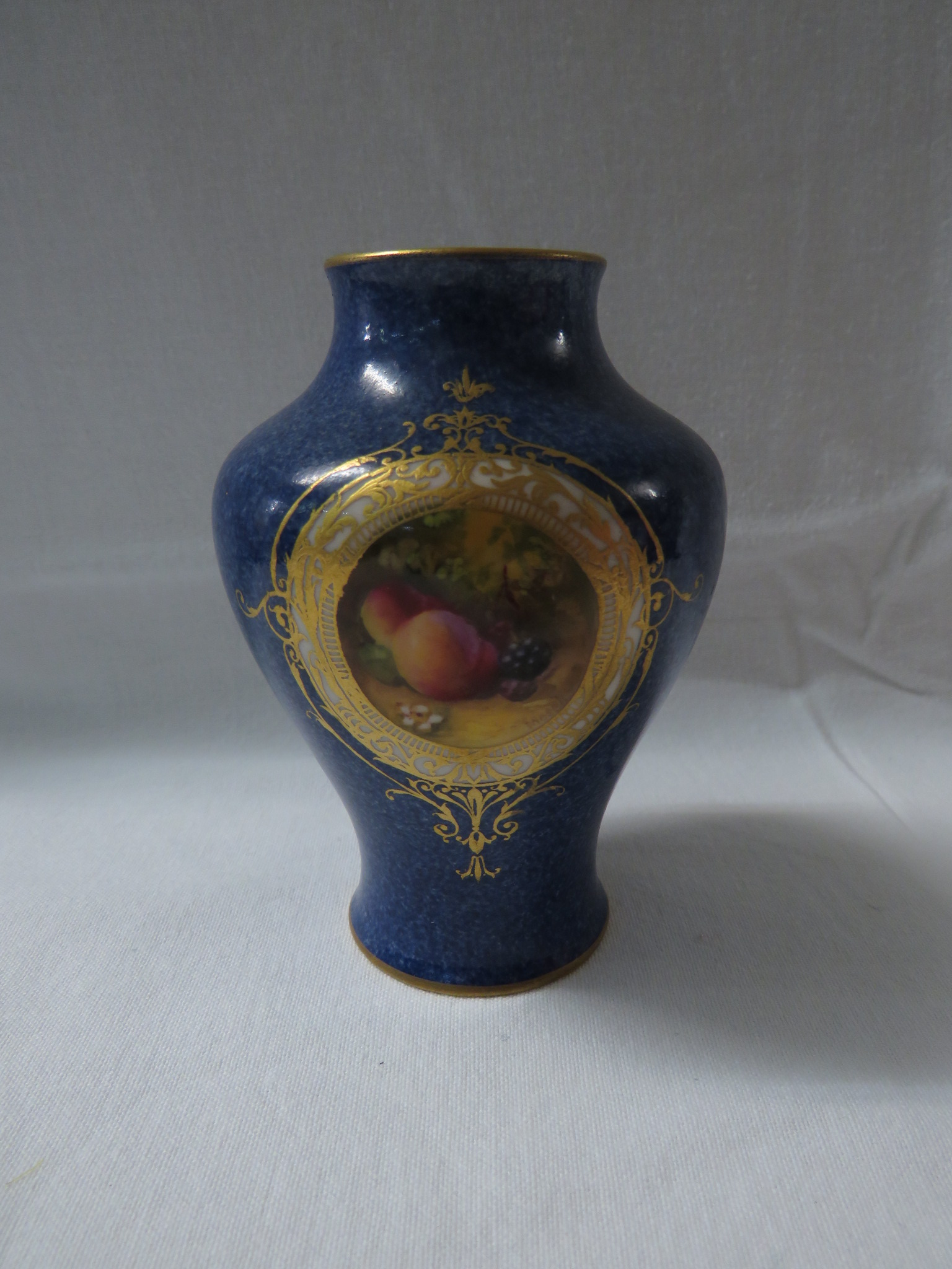 Lot 16 - A small Royal Worcester porcelain vase hand painted by Moseley, high-shouldered form, powder blue,