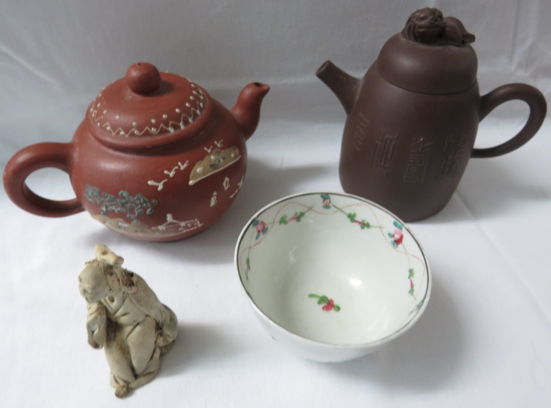 Lot 38 - Chinese Yixing style dark brown pottery tea pot with a lion finial lid, inscriptions to body and