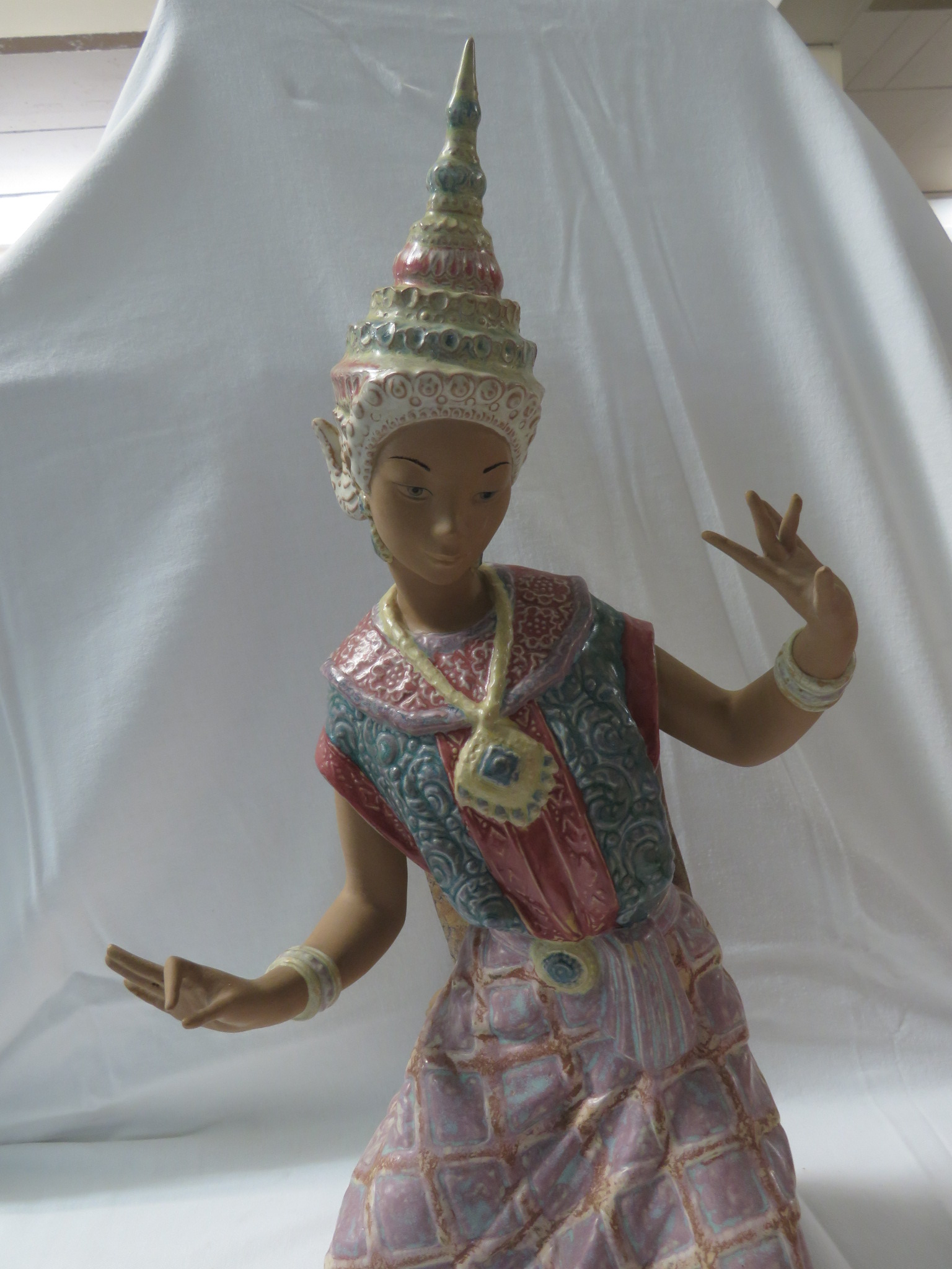 Lot 54 - A Lladro stoneware figure of a kneeling Balinese dancer (height 43cm)