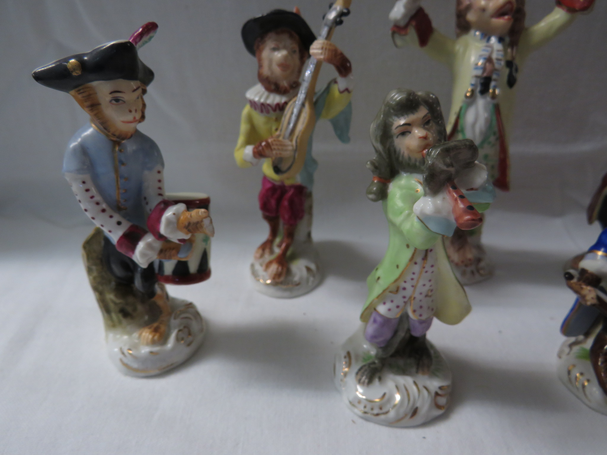Lot 29 - A hand painted porcelain Monkey Orchestra in the style of Meissen comprising a conductor and six