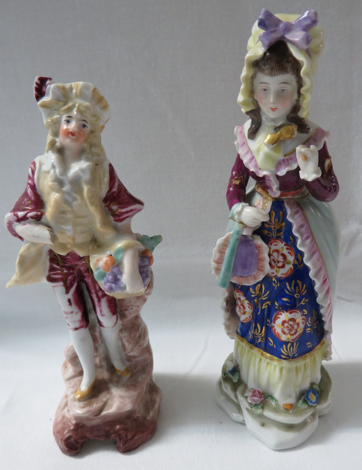 Lot 27 - A continental porcelain figure of lady with fan and lorgnette (damaged) with the mark of Hochst to