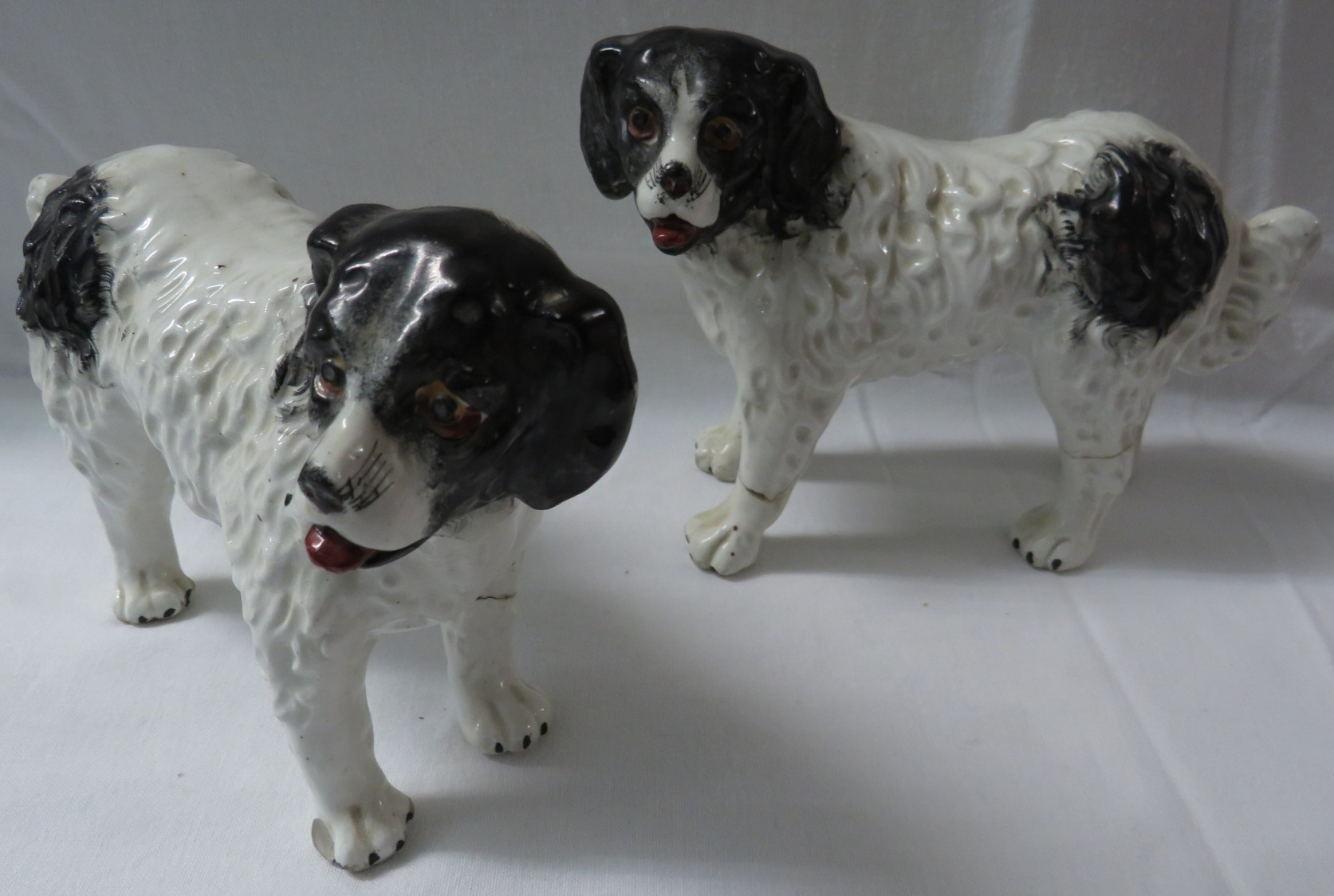 Lot 30 - Pair of 18th century Staffordshire dogs, modelled standing, black and white, height to top of head
