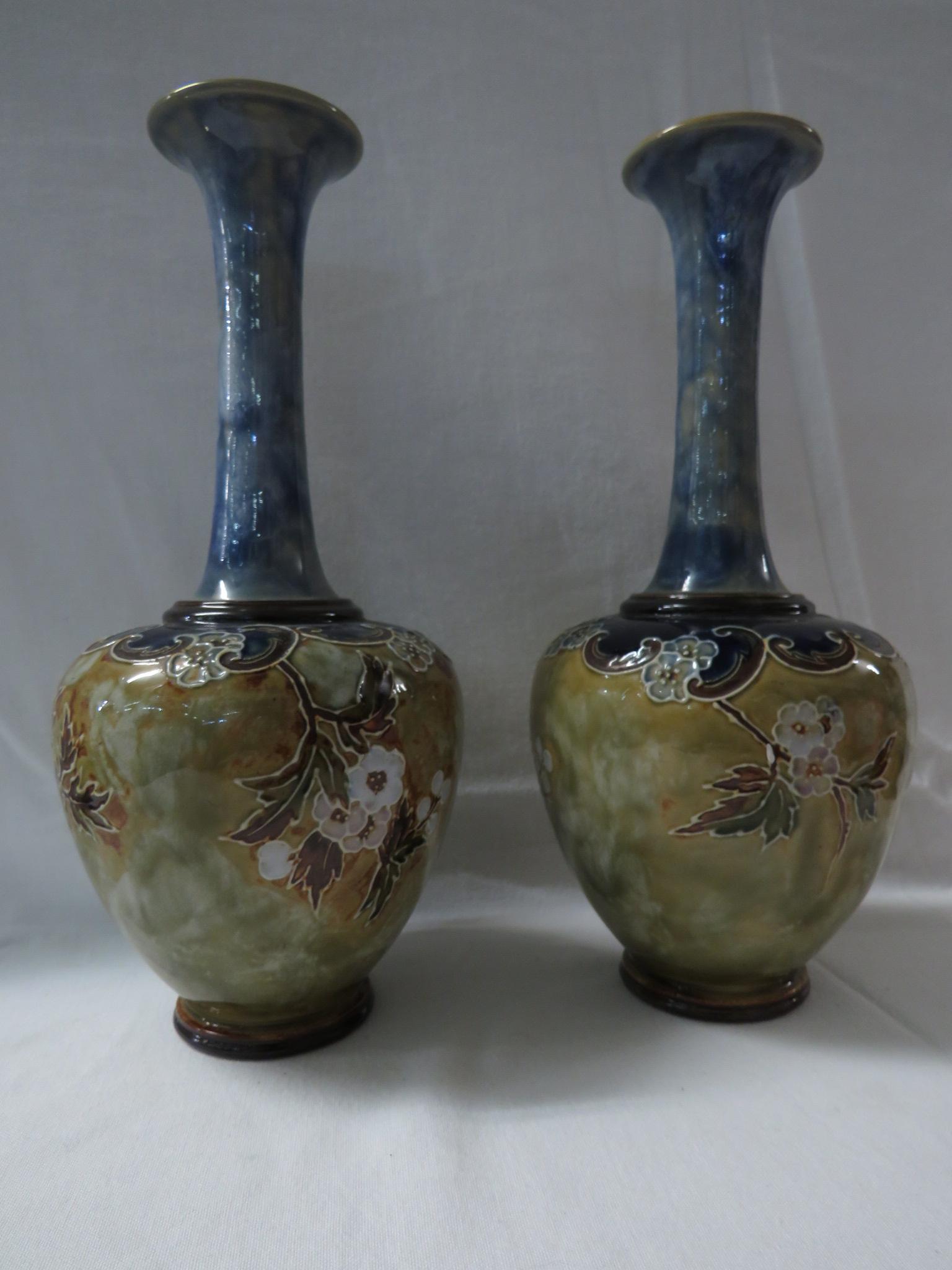 Lot 50 - Pair of Royal Doulton bottle vases, pale blue glazed neck, the bodies with tubed line decoration