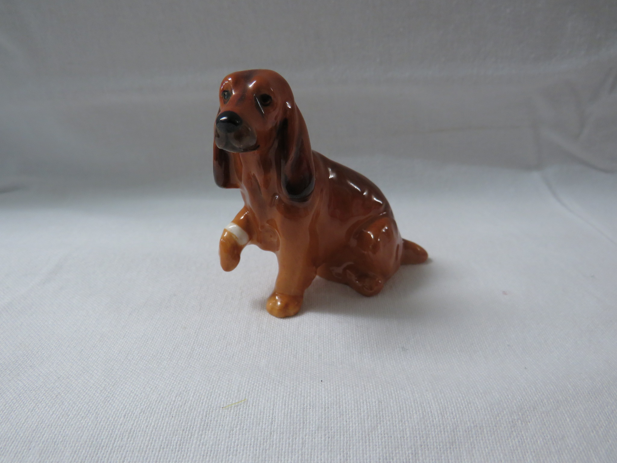 Lot 23 - Doulton Flambe model of a duck (length 8cm), and a Doulton model of a seated brown spaniel with