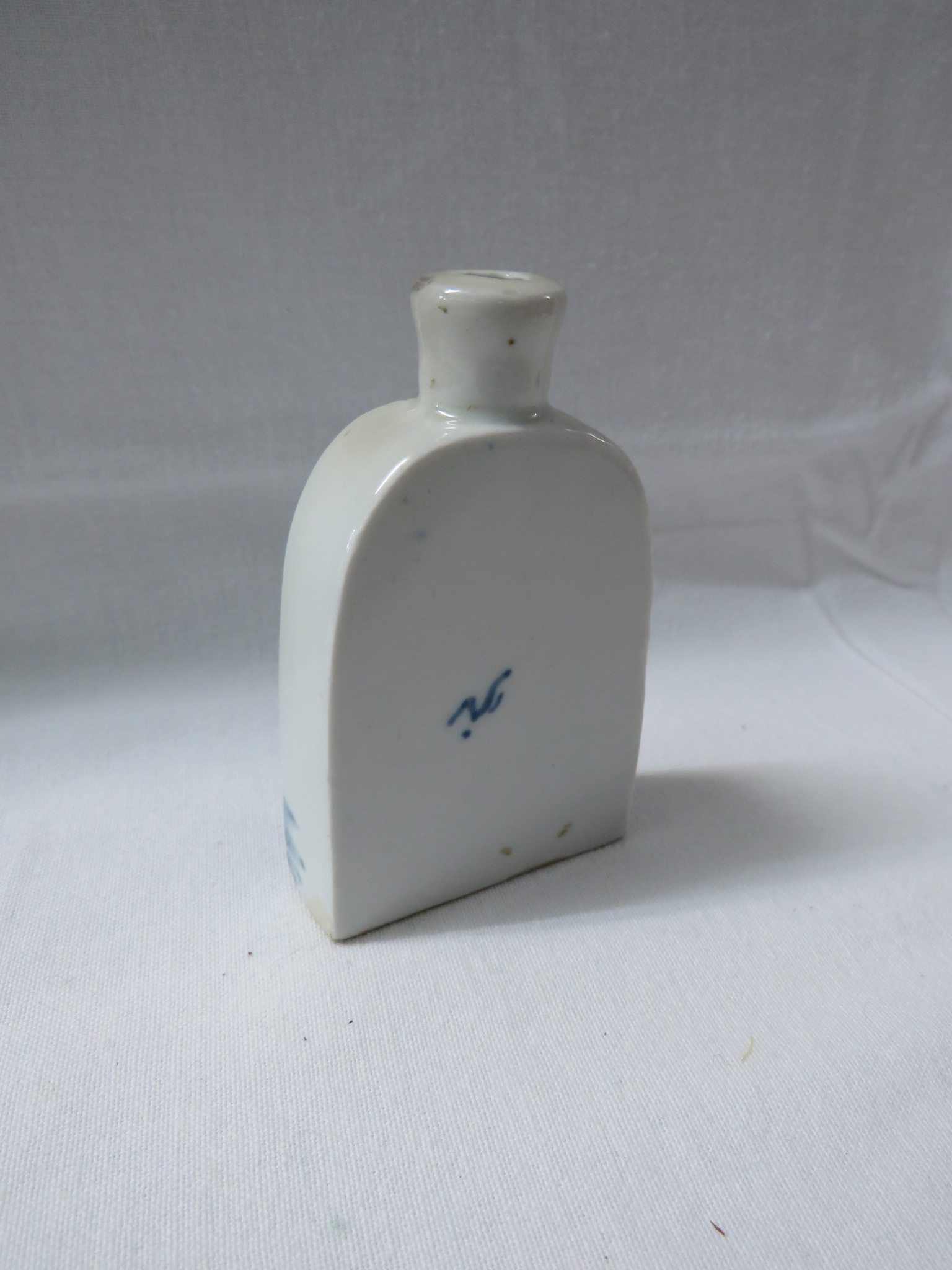 Lot 37 - A Chinese porcelain miniature slab bottle painted to one side with three figures and plants, the