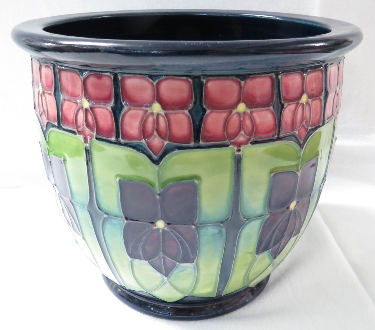 Lot 2 - Moorcroft pottery planter, dark blue green with a repeating decoration in the Art Nouveau manner,
