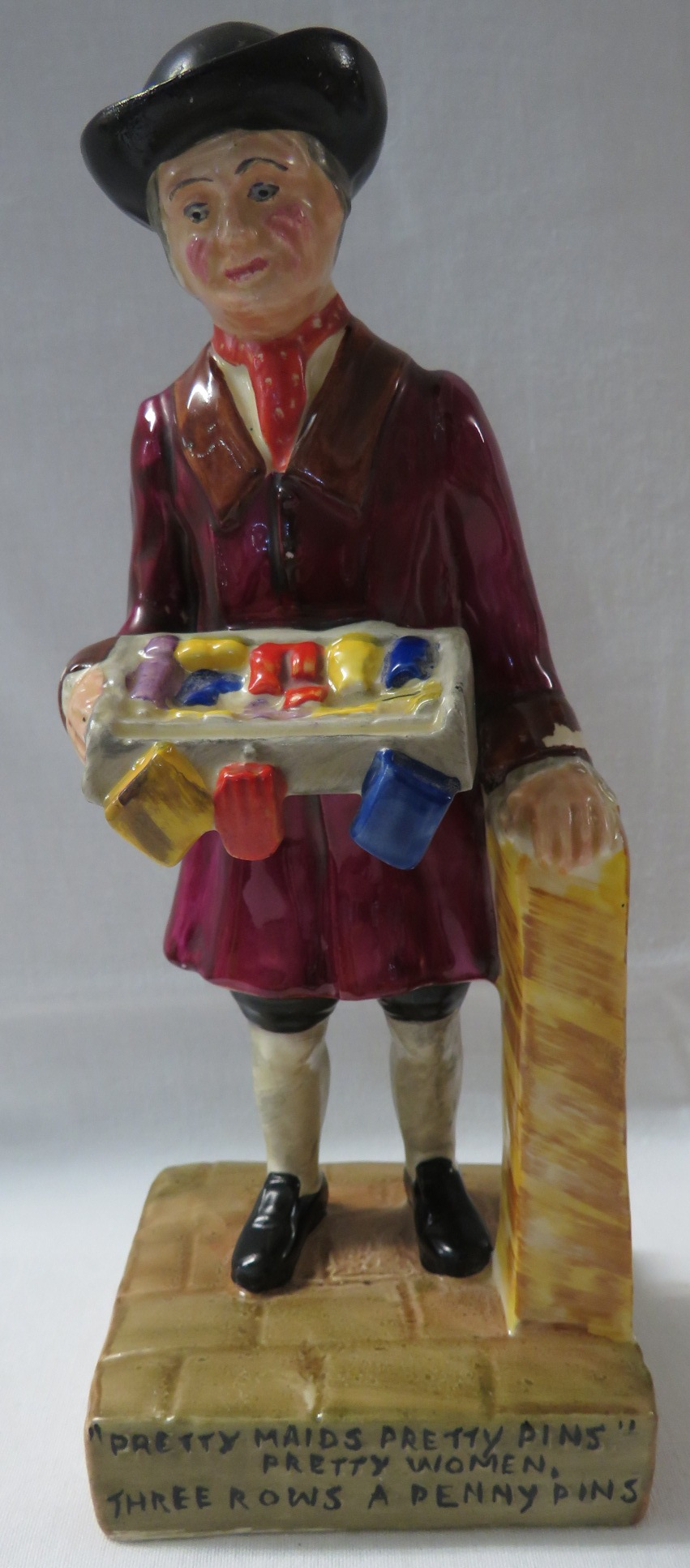 Lot 47 - Wilkinson Ltd Clarice Cliff pottery figure of male street vendor with tray of wares, the base