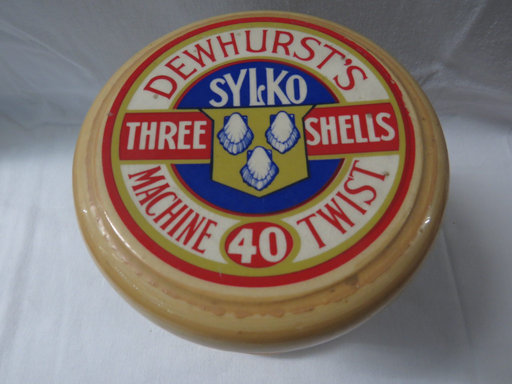 Lot 48 - Late 20th century ceramic jar modelled as a Dewhurst's Sylko reel, a lift out tray within, bearing