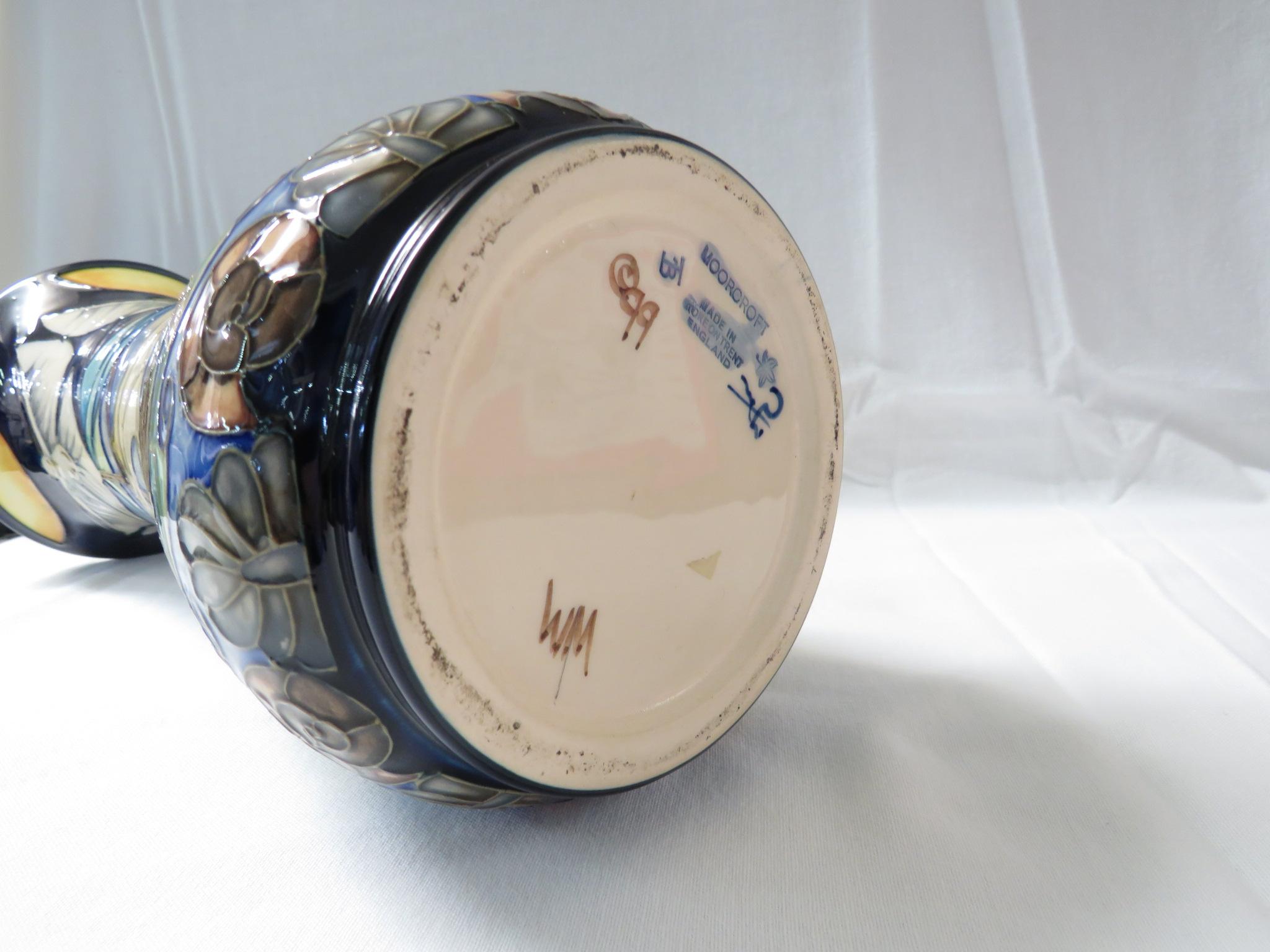 Lot 1 - Moorcroft pottery 'Winds of Change' pattern slender baluster vase, tube lined decoration of doves