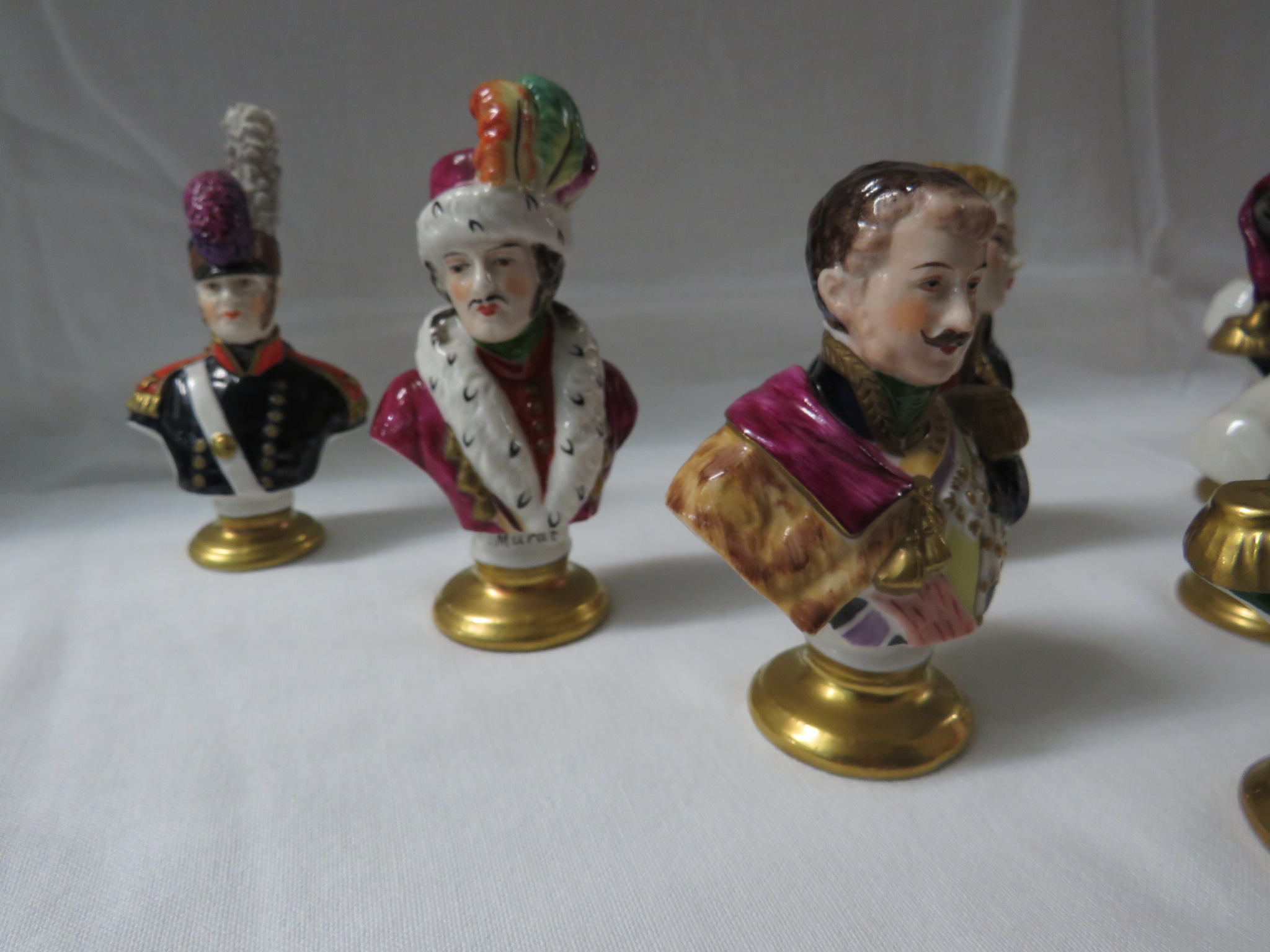 Lot 18 - A set of eight Rudolf Kammer porcelain busts of military figures, each painted with name,