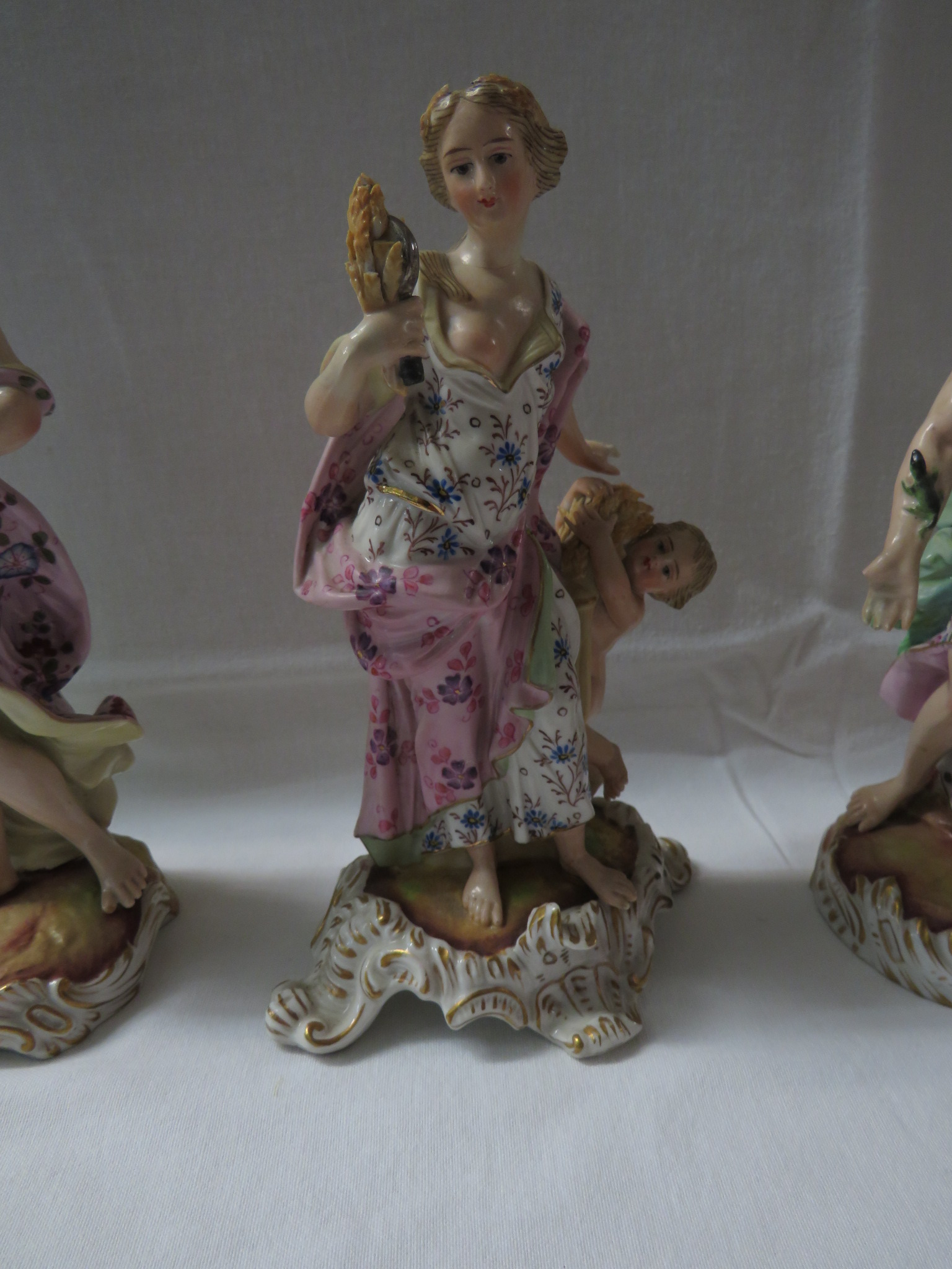 Lot 12 - A matched group of three porcelain Classical and allegorical figures representing Juno, Ceres and
