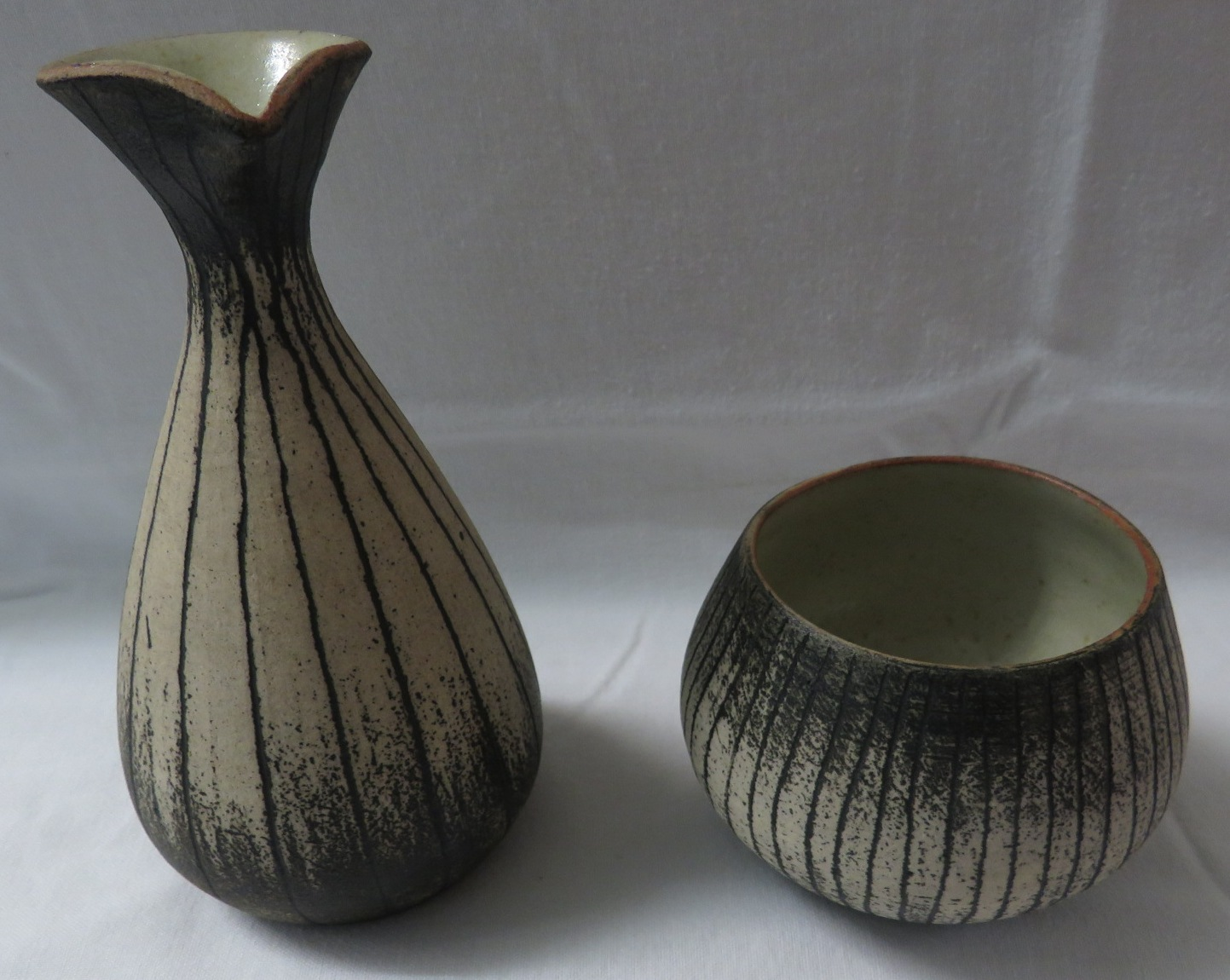 Lot 19 - Waistel Cooper (1921-2003), a stoneware pouring vessel of tapering from (height 15.5cm) and matching