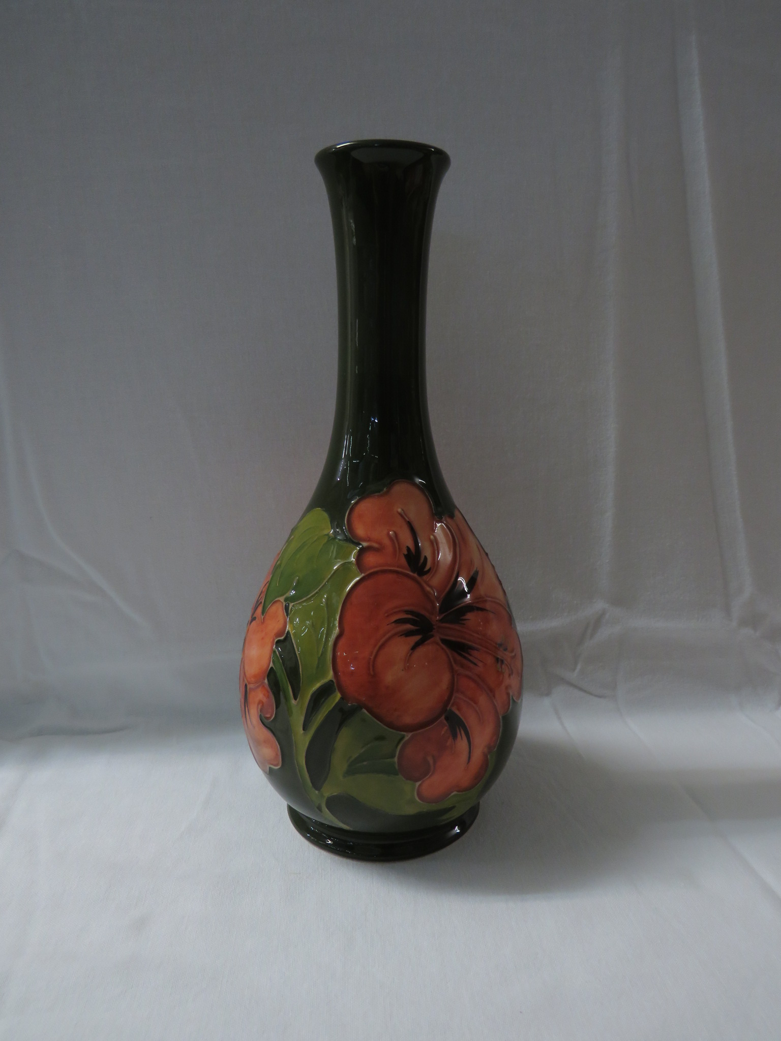 Lot 6 - Moorcroft pottery bottle vase, green ground painted with pink anemones, stamped MOORCROFT MADE IN