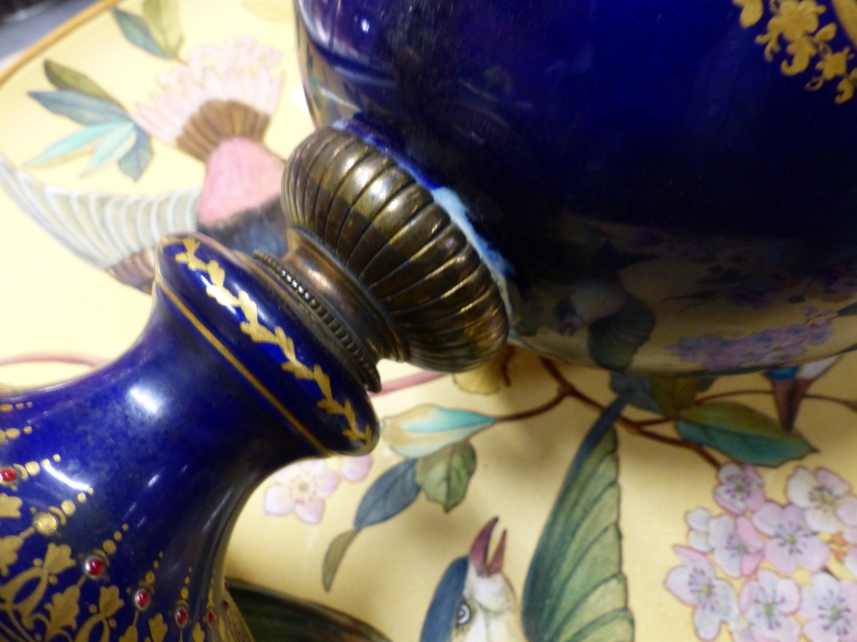Lot 36 - A SEVRES STYLE JEWELLED BLUE GROUND BALUSTER VASE AND COVER PAINTED WITH A ROUNDEL OF A GENTLEMAN